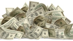 Large Pile of One Hundred Dollar Bills isolated on a white background. Clipping path included. Second of three part series.