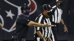 HOUSTON, TEXAS - SEPTEMBER 20: Head coach John Harbaugh of the Baltimore Ravens argues with the official after extra time was put back on the clock and Houston Texans kicked a field goal at NRG Stadium on September 20, 2020 in Houston, Texas. (Photo by
