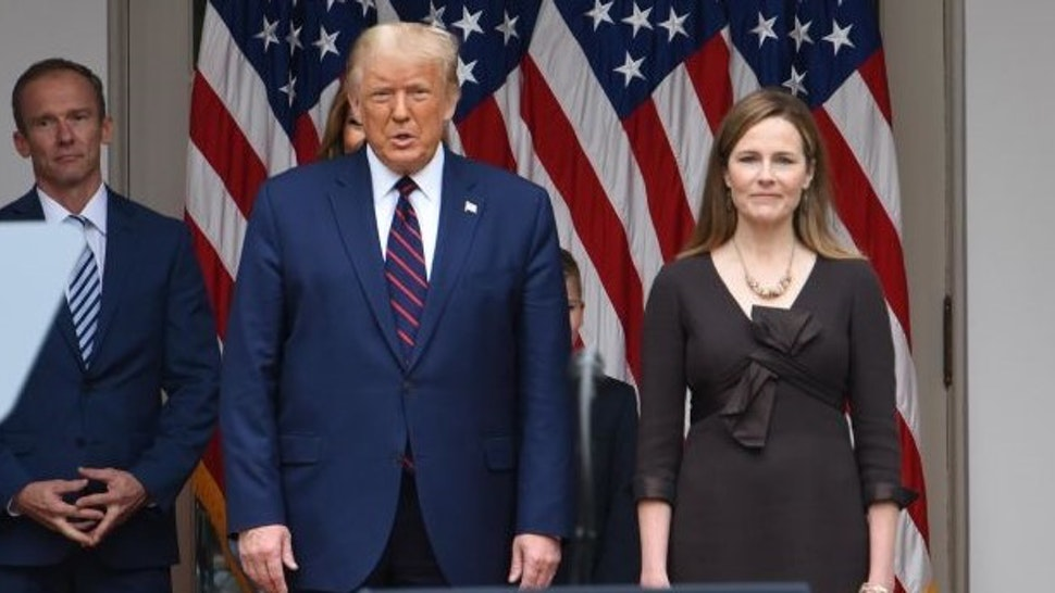 WASHINGTON, DC - SEPTEMBER 26: Amy Coney Barrett (R), U.S. President Donald Trump's nominee for associate justice of the U.S. Supreme Court, and U.S. President Donald Trump arrive for an announcement ceremony at the White House on September 26, 2020 in Washington, DC. (Photo by