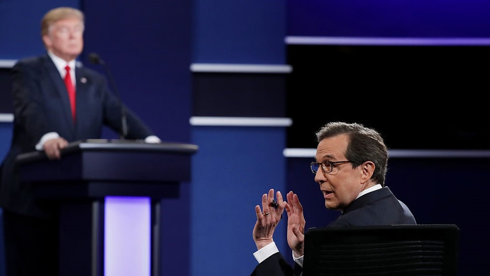 LAS VEGAS, NV - OCTOBER 19: Fox News anchor and moderator Chris Wallace quiets the audience during the third U.S. presidential debate at the Thomas & Mack Center on October 19, 2016 in Las Vegas, Nevada. Tonight is the final debate ahead of Election Day on November 8. (Photo by