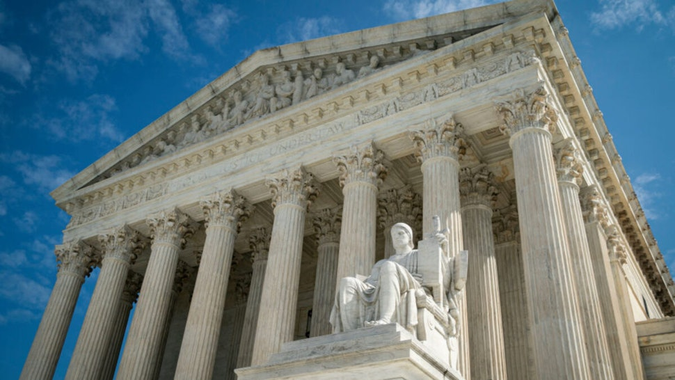The Guardian or Authority of Law, created by sculptor James Earle Fraser, rests on the side of the U.S. Supreme Court on September 28, 2020 in Washington, DC.