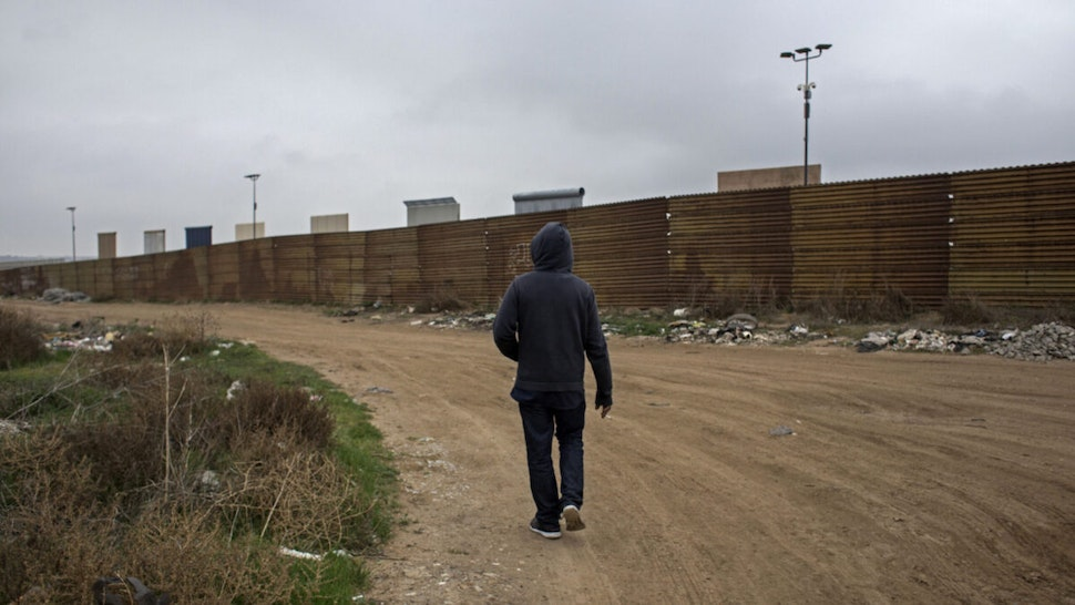US prototypes of the border wall with Mexico, protrude above the current border fence as seen from Tijuana, Baja California state, Mexico on March 10, 2018.