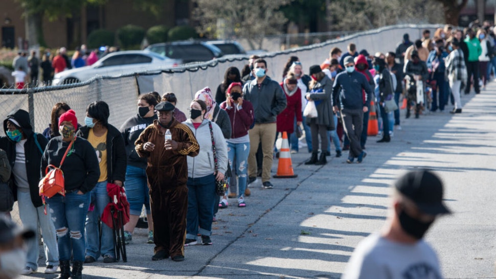 People wait in line to participate in early voting on October 31, 2020 in Greenville, South Carolina. Election Day is November 3.