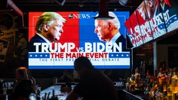 Television screens airing the first presidential debate are seen at Walters Sports Bar on September 29, 2020 in Washington, United States.