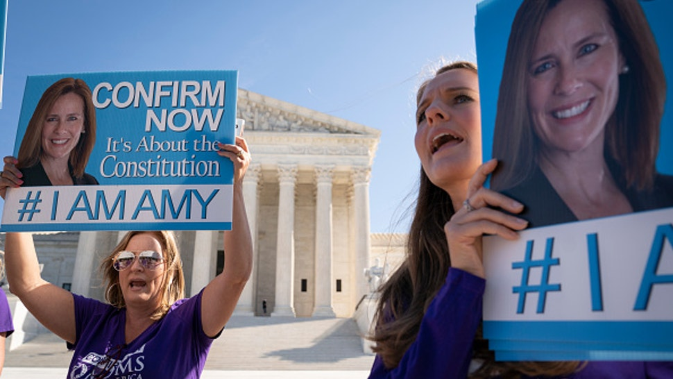 WASHINGTON, DC - OCTOBER 15: Supporters of Supreme Court nominee Judge Amy Coney Barrett demonstrate outside the Supreme Court as the Senate Judiciary Committee continues to consider Barrett's nomination on Capitol Hill on October 15, 2020 in Washington, DC. Barrett was nominated by President Donald Trump to fill the vacancy left by Justice Ruth Bader Ginsburg who passed away in September.