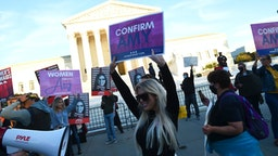 Supporters of Judge Amy Coney Barrett and pro-choice supporters gather outside of the US Supreme Court as the Senate is expected to confirm President Trump's Supreme Court nominee Amy Coney Barrett on Capitol Hill on October 26, 2020 in Washington, DC.