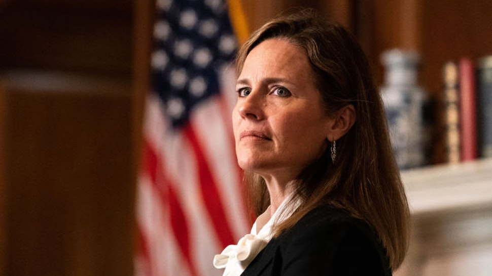 Amy Coney Barrett, U.S. President Donald Trump's nominee for associate justice of the U.S. Supreme Court, meets with Senator Jerry Moran, a Republican from Kansas, not pictured, at the U.S. Capitol in Washington, D.C., U.S., on Thursday, Oct. 1, 2020. A bruising Senate confirmation fight over Trump's Supreme Court choice may seal the fates of several incumbent senators in the November election, though it has yet to drastically alter the odds for which party will control the chamber. Photographer: Anna Moneymaker/The New York Times/Bloomberg