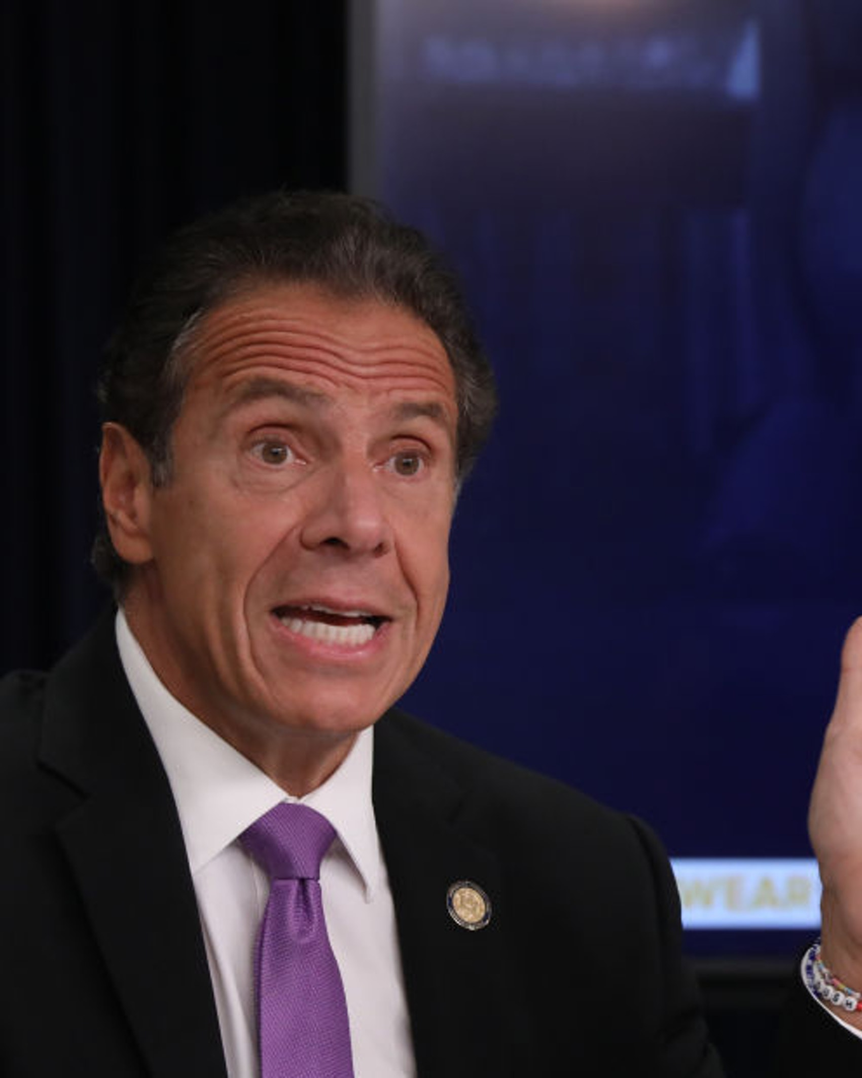A mock up of a newspaper headline and photo of U.S. President Donald Trump is displayed on a screen as New York state Gov. Andrew Cuomo criticizes Trump's handling of COVID-19 at a news conference on September 08, 2020 in New York City. Cuomo, though easing restrictions on casinos and malls throughout the state, has declined to do so for indoor dining in restaurants in New York City despite pressure from business owners, citing struggles by the city to enforce the state's previous orders. (Photo by Spencer Platt/Getty Images)