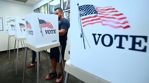 Voters cast their ballots for Early Voting at the Los Angeles County Registrar's Office in Norwalk, California on November 5, 2018, a day ahead the November 6 midterm elections in the United States.