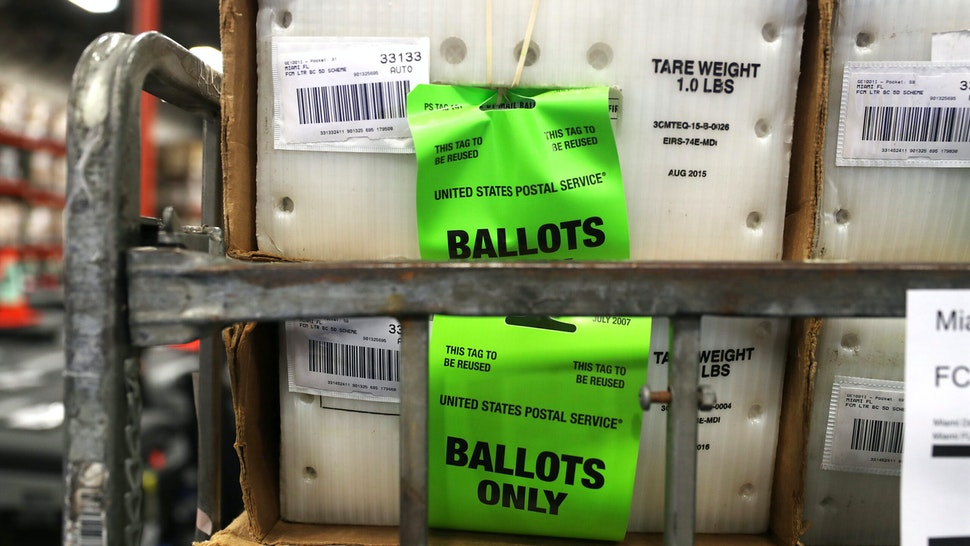 DORAL, FLORIDA - OCTOBER 01: Boxes with ballots are seen at the Miami-Dade County Election Department as the vote-by-mail ballots are placed on to a U.S. Post Office truck to be delivered to voters on October 01, 2020 in Doral, Florida. The Miami-Dade County Elections Department mailed out more than 530,000 vote-by-mail ballots to voters with a request on file for the November 3, 2020 General Election.