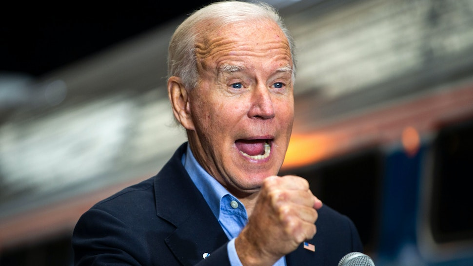 "TOPSHOT - Democratic presidential candidate Joe Biden speaks at the Pittsburgh train station in Pittsburgh, Pennsylvania, on September 30, 2020, during a train campaign tour. - Biden on Wednesday branded his presidential rival's caustic debate performance as a ""national embarrassment"" for not addressing concerns of everyday Americans and failing to clearly denounce white supremacist groups."