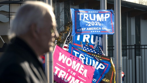 ST. PAUL, MN - OCTOBER 30: Supporters of President Donald Trump rally outside the gates of the venue as Democratic presidential nominee Joe Biden speaks during a drive-in campaign rally at the Minnesota State Fairgrounds on October 30, 2020 in St. Paul, Minnesota. Biden is campaigning in Iowa, Wisconsin and Minnesota on Friday.