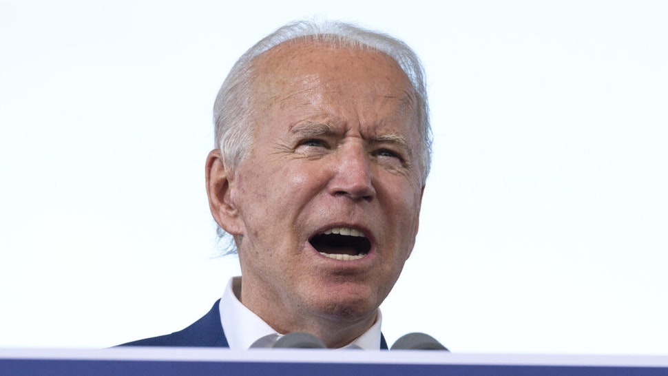 """Democratic Presidential Candidate Joe Biden speaks during a drive in rally in Miramar, Florida on October 13, 2020. - Joe Biden headed for Florida to court elderly Americans who helped elect Donald Trump four years ago but appear to be swinging to the Democratic candidate for the White House this time around amid the coronavirus pandemic. Biden, at 77 the oldest Democratic nominee ever, is to """"deliver his vision for older Americans"""" at an event in the city of Pembroke Pines, north of Miami, his campaign said."""