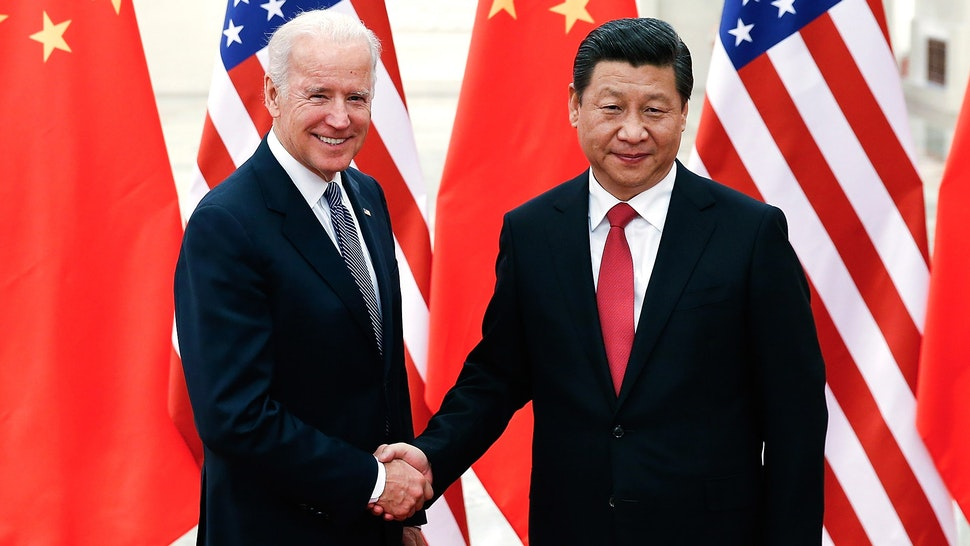 BEIJING, CHINA - DECEMBER 04: Chinese President Xi Jinping (R) shake hands with U.S Vice President Joe Biden (L) inside the Great Hall of the People on December 4, 2013 in Beijing, China. U.S Vice President Joe Biden will pay an official visit to China from December 4 to 5.