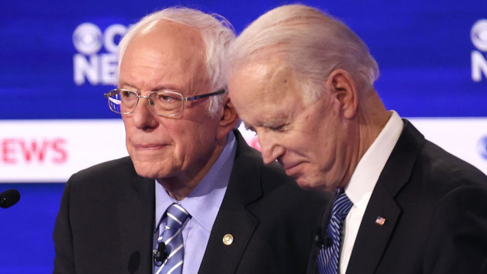CHARLESTON, SOUTH CAROLINA - FEBRUARY 25: Democratic presidential candidates Sen. Bernie Sanders (I-VT) and former Vice President Joe Biden speak during a break at the Democratic presidential primary debate at the Charleston Gaillard Center on February 25, 2020 in Charleston, South Carolina. Seven candidates qualified for the debate, hosted by CBS News and Congressional Black Caucus Institute, ahead of South Carolina's primary in four days.
