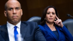 "Sens. Cory Booker, D-N.J., and Kamala Harris, D-Calif., attend the Senate Judiciary Committee hearing titled ""Police Use of Force and Community Relations,"" in Dirksen Senate Office Building in Washington, D.C., on Tuesday, June 16, 2020. (Photo By Tom Williams/CQ Roll Call/POOL)"
