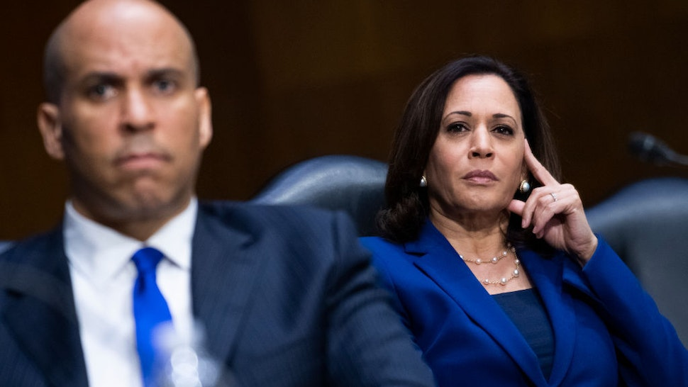 """Sens. Cory Booker, D-N.J., and Kamala Harris, D-Calif., attend the Senate Judiciary Committee hearing titled """"Police Use of Force and Community Relations,"""" in Dirksen Senate Office Building in Washington, D.C., on Tuesday, June 16, 2020. (Photo By Tom Williams/CQ Roll Call/POOL)"""