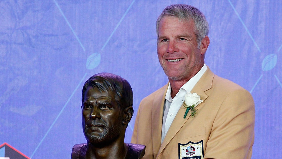 CANTON, OH - AUGUST 06: Brett Favre, former NFL quarterback, poses with his bronze bust during the NFL Hall of Fame Enshrinement Ceremony at the Tom Benson Hall of Fame Stadium on August 6, 2016 in Canton, Ohio. (Photo by Joe Robbins/Getty Images)