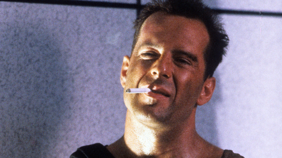 Bruce Willis with cigarette in a scene from the film 'Die Hard', 1988.