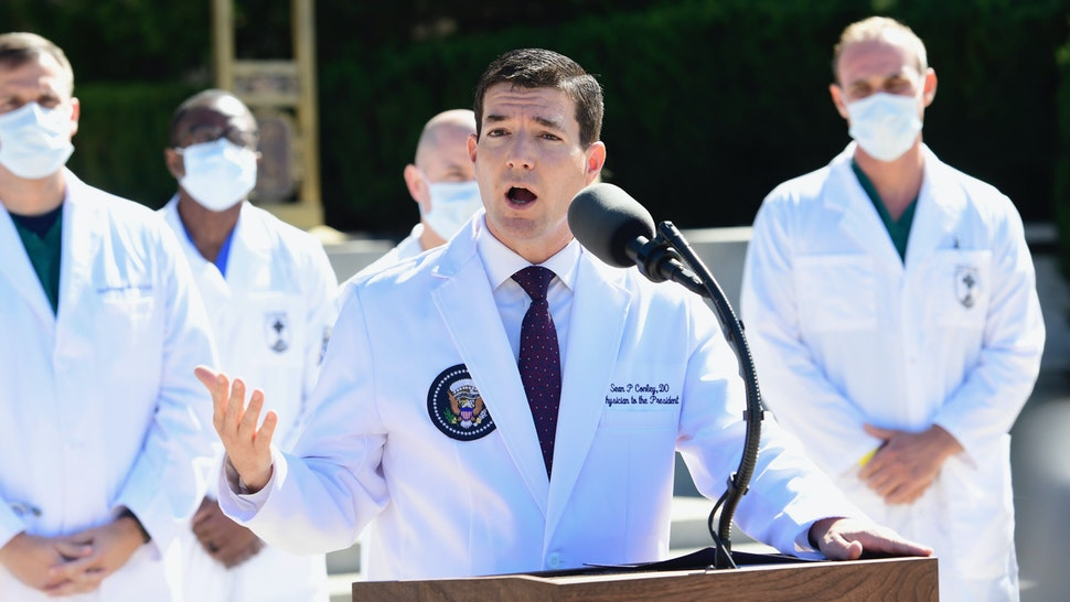 "Dr. Sean Conley, White House physician, speaks during a press conference outside of Walter Reed National Military Medical Center in Bethesda, Maryland, U.S., on Saturday, Oct. 3, 2020. Dr. Conley said the president is ""doing very well"" and his condition is improving while being treated at the U.S. military hospital near Washington for Covid-19."