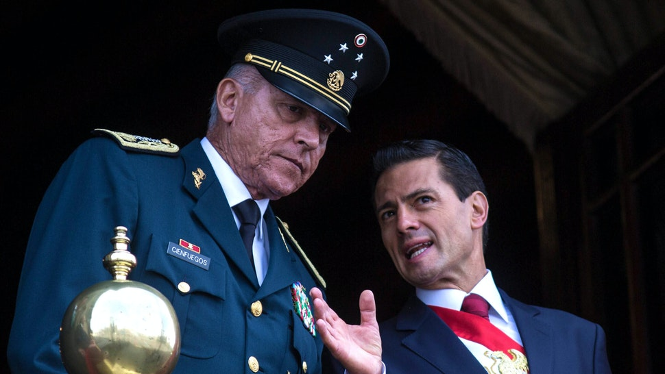 MEXICO CITY, MEXICO - SEPTEMBER 16 : President of Mexico Enrique Pena Nieto (R) and Defense Secretary Salvador Cienfuegos Zepeda watch the annual military parade at Zocalo main square, in Mexico City, Mexico on September 16, 2016. Mexico is marking the 206th anniversary of its independence.