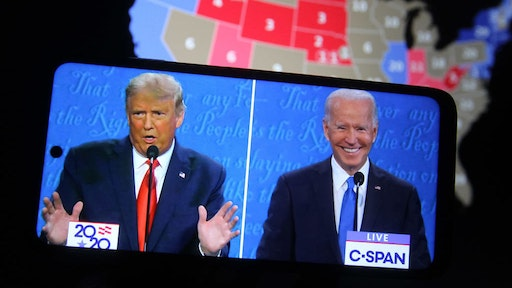 In this photo illustration the US President Donald Trump and Democratic presidential candidate and former US Vice President Joe Biden are seen during the final presidential debate displayed on a screen of a smartphone. The final presidential debate between President Donald Trump and former Vice President Joe Biden took place at Belmont University in Nashville, the U.S. on Thursday, October 22. United States presidential election scheduled for November 3, 2020. (Photo Illustration by Pavlo Conchar/SOPA Images/LightRocket via Getty Images)