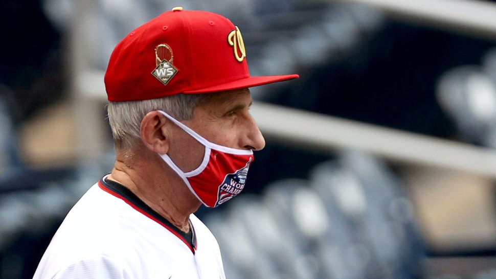 WASHINGTON, DC - JULY 23: Dr. Anthony Fauci, director of the National Institute of Allergy and Infectious Diseases looks on before throwing out the ceremonial first pitch prior to the game between the New York Yankees and the Washington Nationals at Nationals Park on July 23, 2020 in Washington, DC.