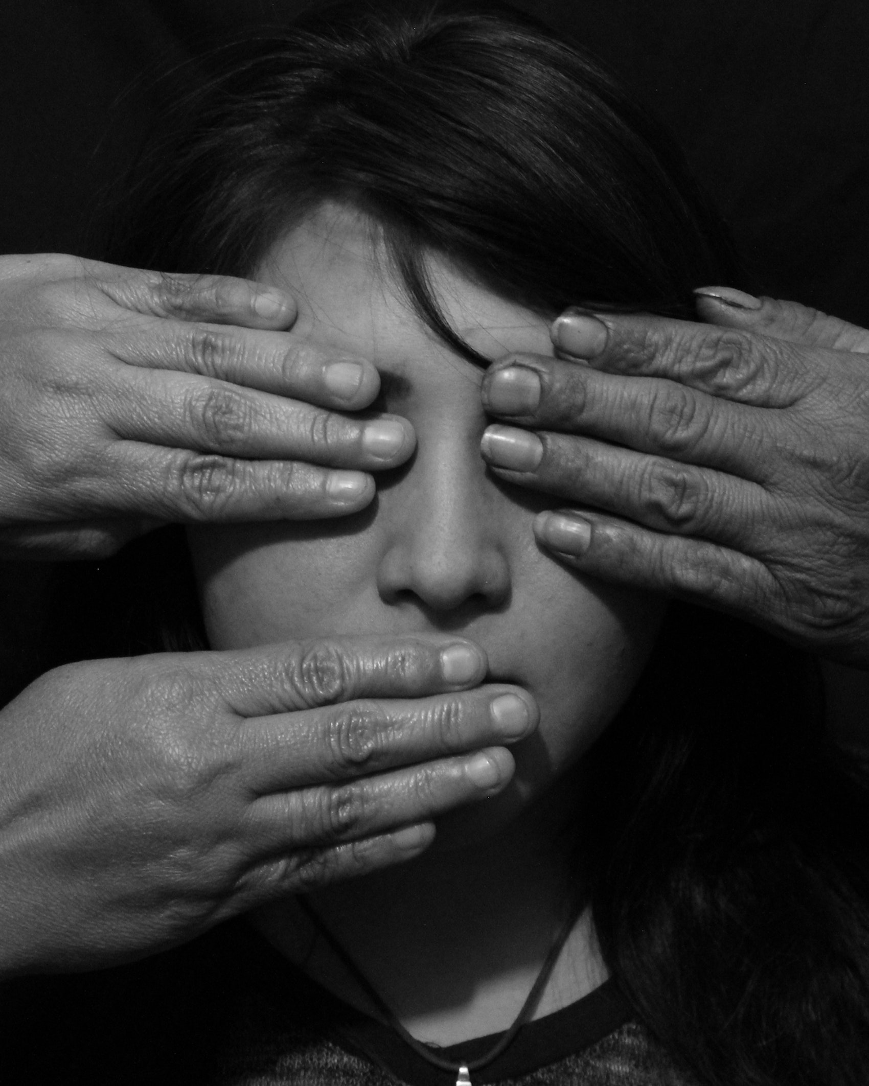 Close-Up Of A Hands On Womans Face