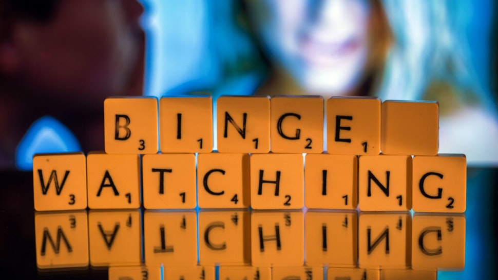"""ILLUSTRATION - The English word """"binge-watching"""" spelled out in Scrabble letters in Schwerin, Germany, 5 November 2015. The expression, describing continuous television viewing, was named word of the year by the British Collin's dictionary."""