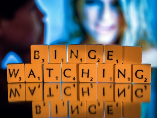 "ILLUSTRATION - The English word ""binge-watching"" spelled out in Scrabble letters in Schwerin, Germany, 5 November 2015. The expression, describing continuous television viewing, was named word of the year by the British Collin's dictionary."