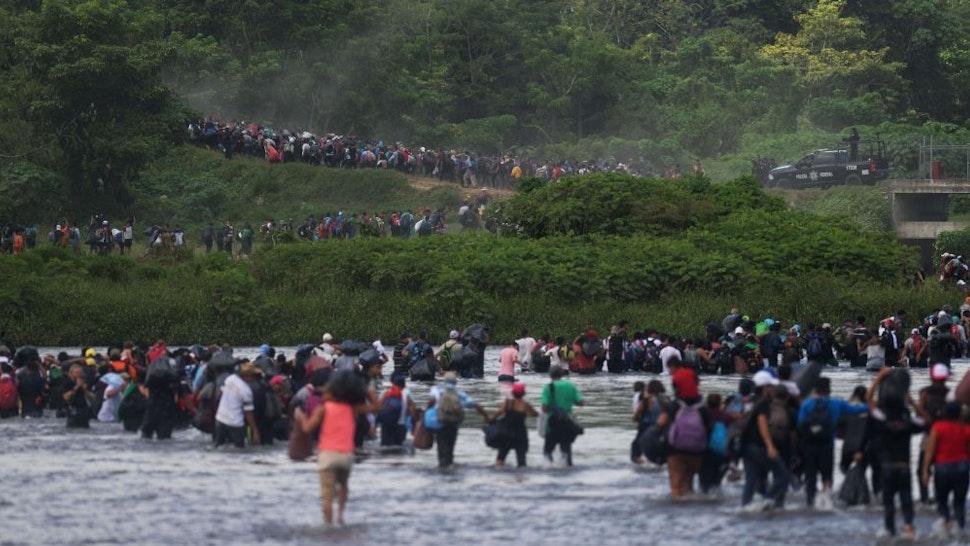 Salvadorean migrants heading in a caravan to the US, cross the Suchiate River to Mexico, as seen from Ciudad Tecun Uman, Guatemala, on November 02, 2018.