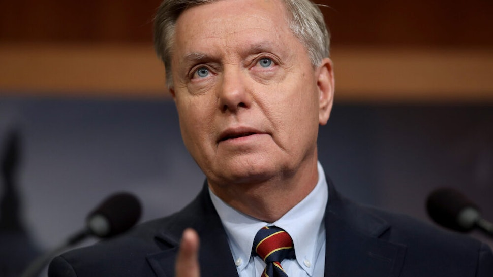 WASHINGTON, DC - DECEMBER 20: Sen. Lindsey Graham (R-SC) speaks during a press conference at the U.S. Capitol on December 20, 2018 in Washington, DC. Graham and Sen. Robert Menendez (D-NJ) and Sen. Jack Reed (D-RI) spoke out against U.S. President Donald Trump's decision to remove U.S. military forces from Syria.