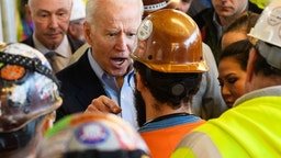 """Democratic presidential candidate Joe Biden has heated exchange meets workers and discusses gun rights as he tours the Fiat Chrysler plant in Detroit, Michigan on March 10, 2020. - Biden opened primary day meeting workers at an under-construction automobile plant in Detroit, where he received cheers but also was confronted by one worker. In an exchange avidly shared online by Trump supporters, the worker, wearing a construction helmet and reflective vest, accused Biden of seeking to weaken the constitutional right to own firearms. """"You're full of shit,"""" Biden shot back. """"I support the Second Amendment."""" When the worker pressed the issue, Biden, visibly agitated and with a raised voice, said """"I'm not taking your gun away,"""" adding, """"Gimme a break, man."""" (Photo by MANDEL NGAN / AFP)"""