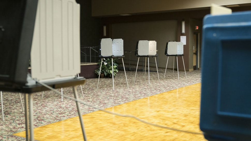 Voting booths sit empty at a polling location in Minneapolis, Minnesota, U.S., on Tuesday, Aug. 11, 2020.