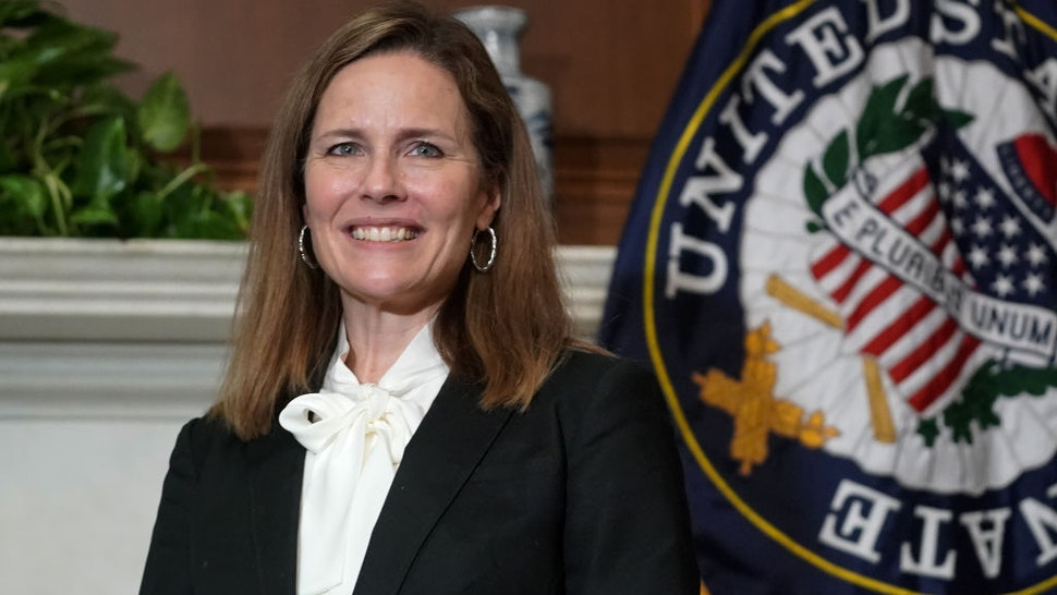 Seventh U.S. Circuit Court Judge Amy Coney Barrett, President Donald Trump's nominee for the U.S. Supreme Court, meets with Sen. Bill Cassidy (R-LA) as she prepares for her confirmation hearing, on Capitol Hill on October 1, 2020 in Washington, DC.