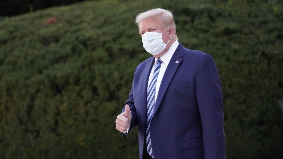U.S. President Donald Trump gestures outside of Walter Reed National Military Medical Center in Bethesda, Maryland, U.S., on Monday, Oct. 5, 2020.