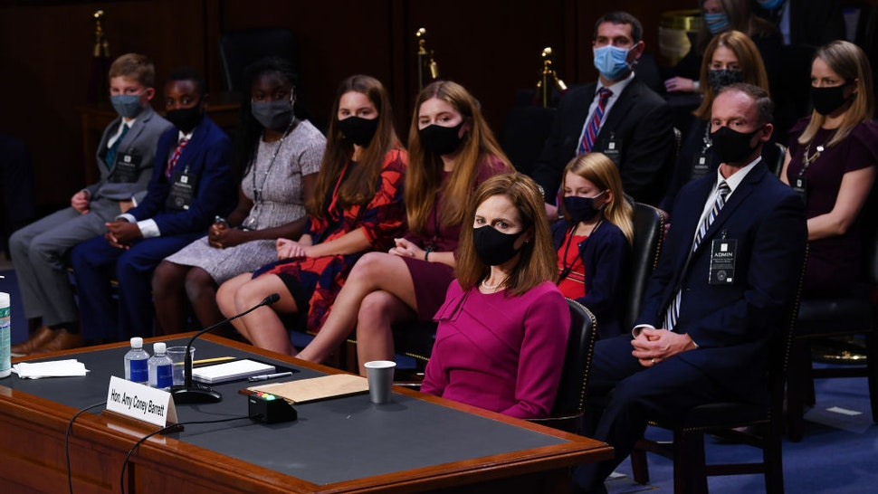 Supreme Court Justice nominee Judge Amy Coney Barrett sits near her family during the Senate Judiciary Committee confirmation hearing for Supreme Court Justice on Capitol Hill on October 12, 2020 in Washington, DC.