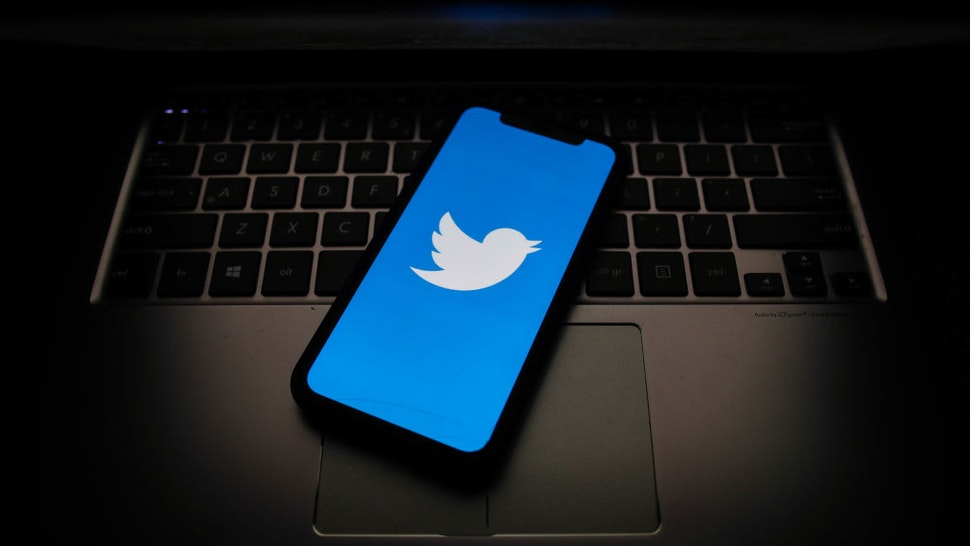 witter logo displayed on a phone screen is seen in this illustration photo taken on October 18, 2020. (Photo Illustration by Jakub Porzycki/NurPhoto via Getty Images)