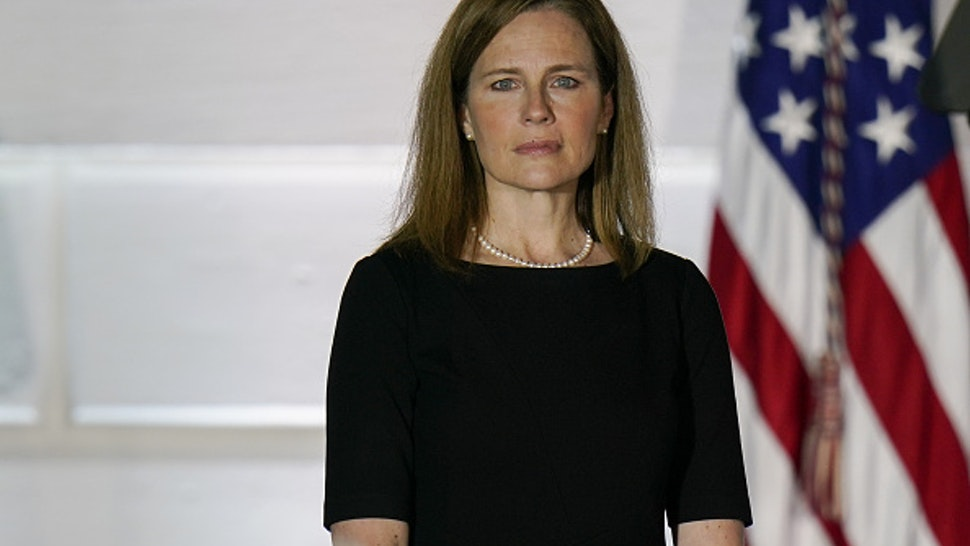 Amy Coney Barrett, associate justice of the U.S. Supreme Court, stands during a ceremony on the South Lawn of the White House in Washington, D.C., U.S., on Monday, Oct. 26, 2020. The Senate voted 52-48 Monday to confirm Barrett to the Supreme Court, giving the court a 6-3 conservative majority that could determine the future of the Affordable Care Act and abortion rights.