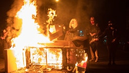 Protesters set a sofa on fire in West Philadelphia on October 27, 2020, during a demonstration against the fatal shooting of 27-year-old Walter Wallace, a Black man, by police.