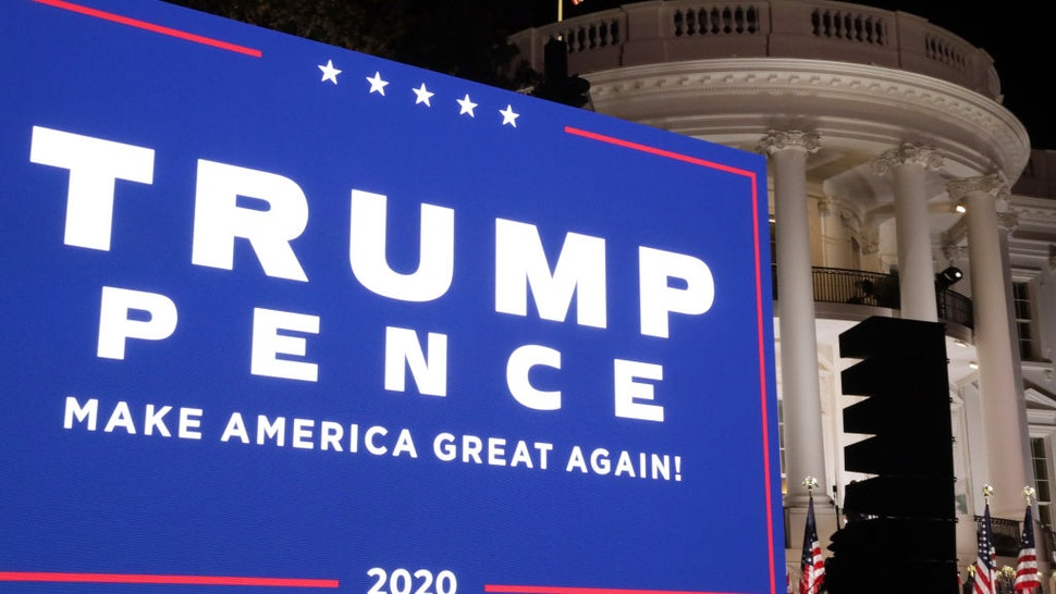 A screen displays the campaign banner for U.S. President Trump and Vice President Mike Pence following Trump's acceptance speech for the Republican presidential nomination on the South Lawn of the White House August 27, 2020 in Washington, DC.