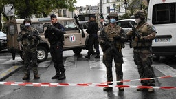 Officers of the French National Gendarmerie stand guard after a man armed with a knife attacked people near the former offices of the satirical magazine Charlie Hebdo on September 25, 2020 in Paris, France.