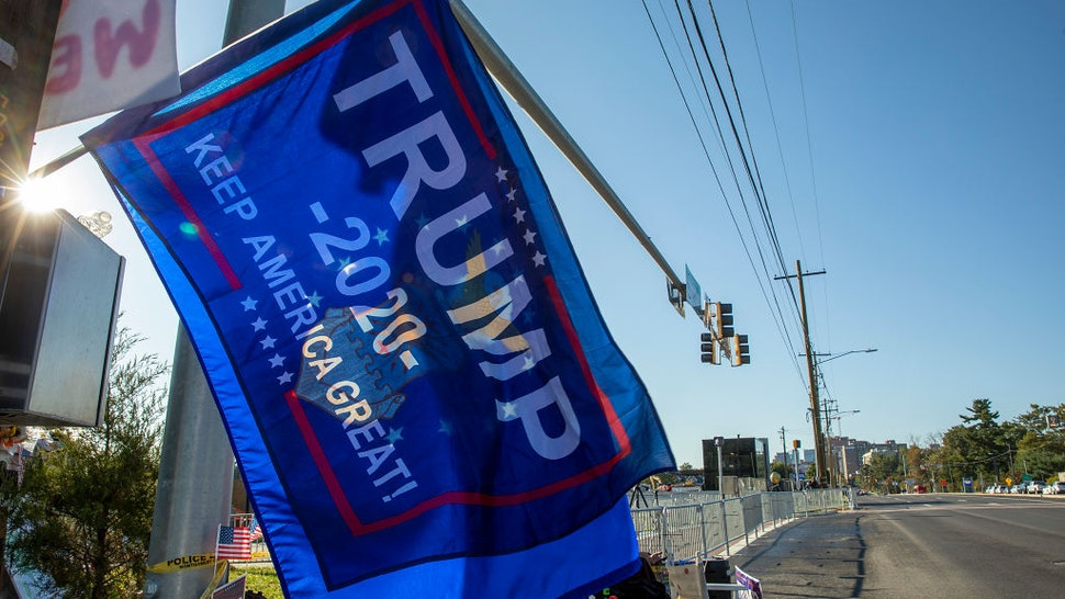 Supporters of President Donald Trump fly a banner outside Walter Reed National Military Medical Center after the President was admitted for treatment of COVID-19 on October 5, 2020 in Bethesda, Maryland.