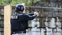 Man Shooting 9mm Handgun Shooting Range - stock photo