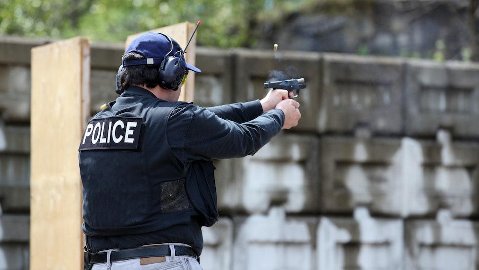 Man Shooting 9mm Handgun Shooting Range - stock photo