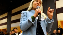 "Routt County Commissioner Diane Mitsch Bush asks a question of keynote speaker U.S. Transportation Secretary Ray LaHood during the Q&A portion of the ""Putting Colorado to Work"" jobs forum at the University of Denver."