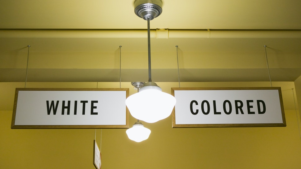 White and Colored segregation signs - stock photo