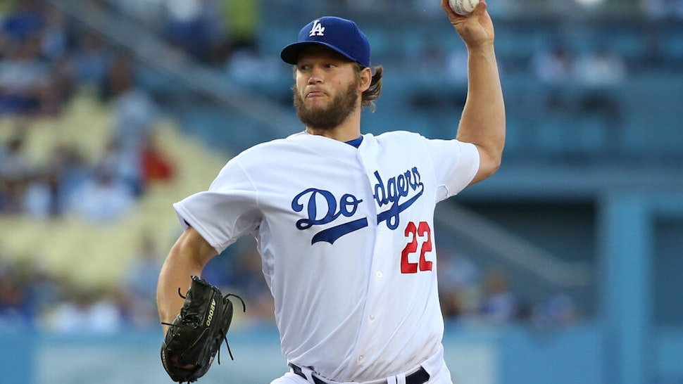 LOS ANGELES, CA - JUNE 18: Pitcher Clayton Kershaw #22 of the Los Angeles Dodgers pitches in the first inning during the MLB game against the Colorado Rockies at Dodger Stadium on June 18, 2014 in Los Angeles, California.