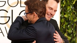 Actors Robert Downey Jr. and Chris Pratt (R) attend the 72nd Annual Golden Globe Awards at The Beverly Hilton Hotel on January 11, 2015 in Beverly Hills, California.