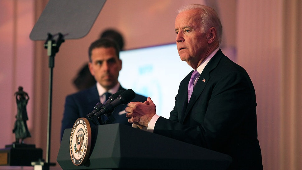 WASHINGTON, DC - APRIL 12: Hunter Biden (L) and U.S. Vice President Joe Biden speak on stage at the World Food Program USA's Annual McGovern-Dole Leadership Award Ceremony at Organization of American States on April 12, 2016 in Washington, DC. (Photo by Teresa Kroeger/Getty Images for World Food Program USA)